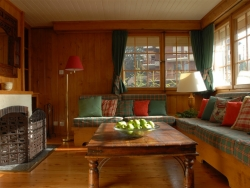 The comfortable sitting room of Chalet Payana with a warming log fire