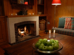 The comfortable sitting room of Chalet Payana with a charming log fire
