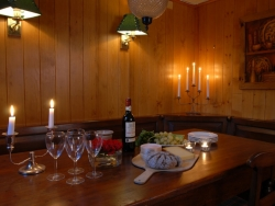 The lounge of Chalet Payana with a roaring log fire