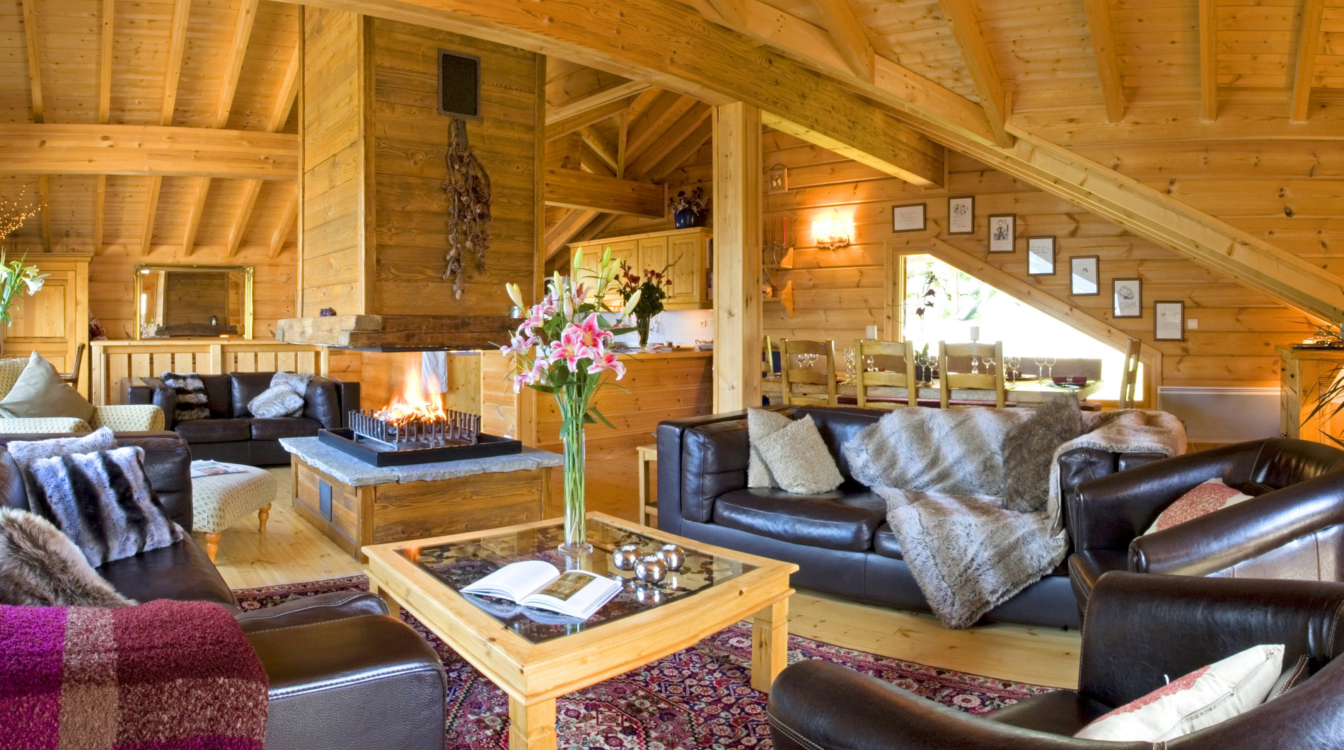 The living area of Chalet Johanna ***** with a wonderful log fire