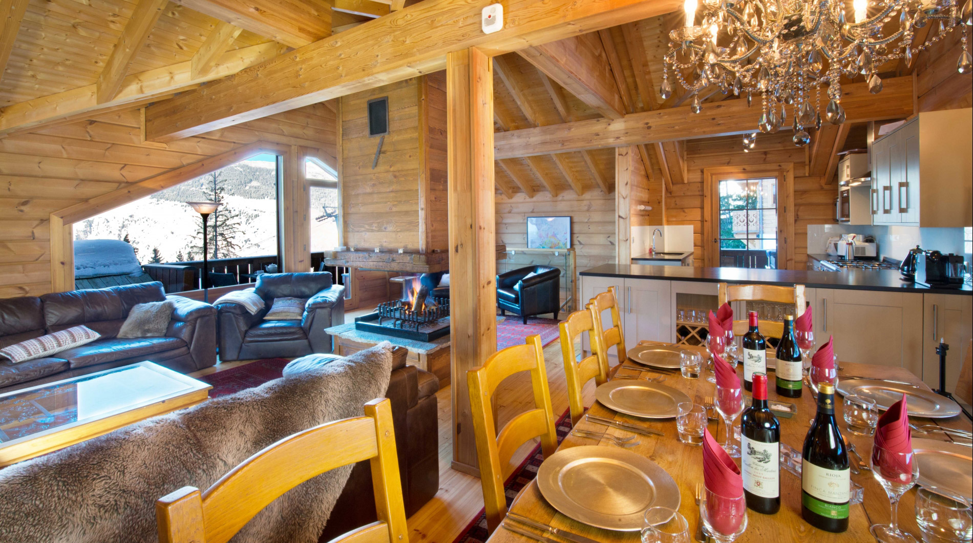 The spacious lounge of Chalet Johanna ***** with a roaring log fire