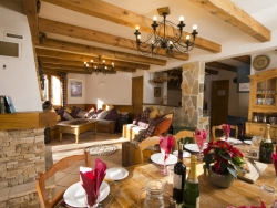 The lounge of Chalet Lea with a warming log fire