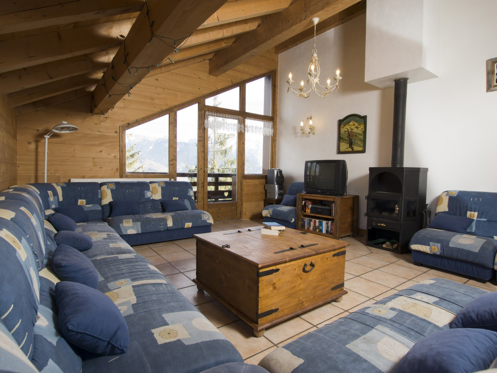 The lounge of Chalet Balkiss with a warming log fire