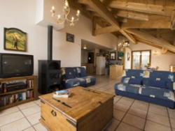 The spacious lounge of Chalet Balkiss with a warming log fire