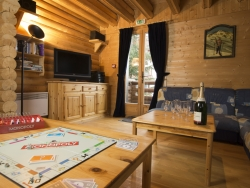 The living room of Chalet Christine with a charming log fire