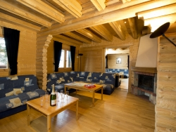 The lounge of Chalet Christine with a splendid log fire