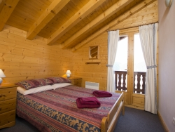 One of Chalet Anniek's charming bedrooms, we accommodate up to 16