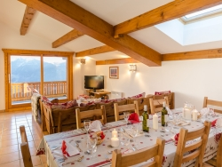 The Chalet's spacious lounge and dining area offers spectacular views of the surrounding area