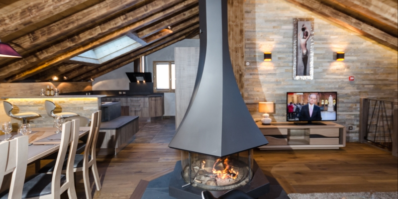 The comfortable sitting room of Chalet Emilie with a wonderful log fire