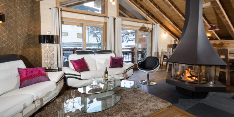 The spacious lounge of Chalet Emilie with a wonderful log fire
