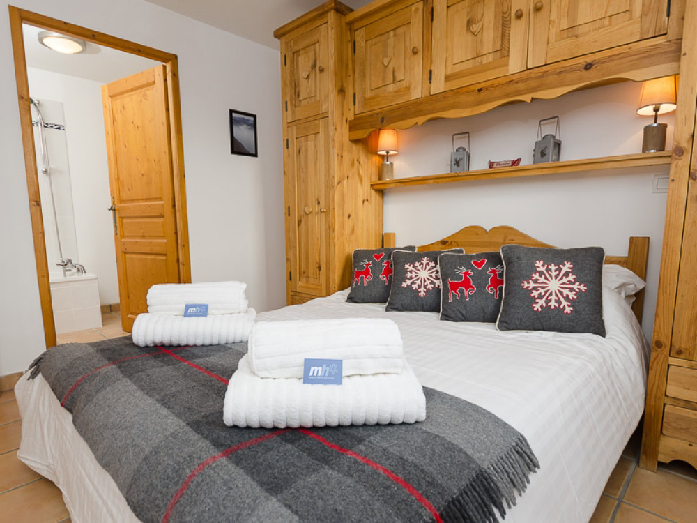The chalet has beautiful bedrooms to relax and enjoy a well deserved rest