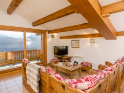 The spacious and charming lounge of Chalet Valerie offering free wifi