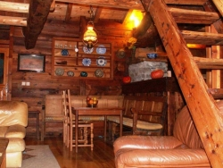 The comfortable sitting room of Chalet Laiterie with a wonderful log fire