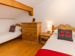 One of the chalet's traditional yet charming bedrooms