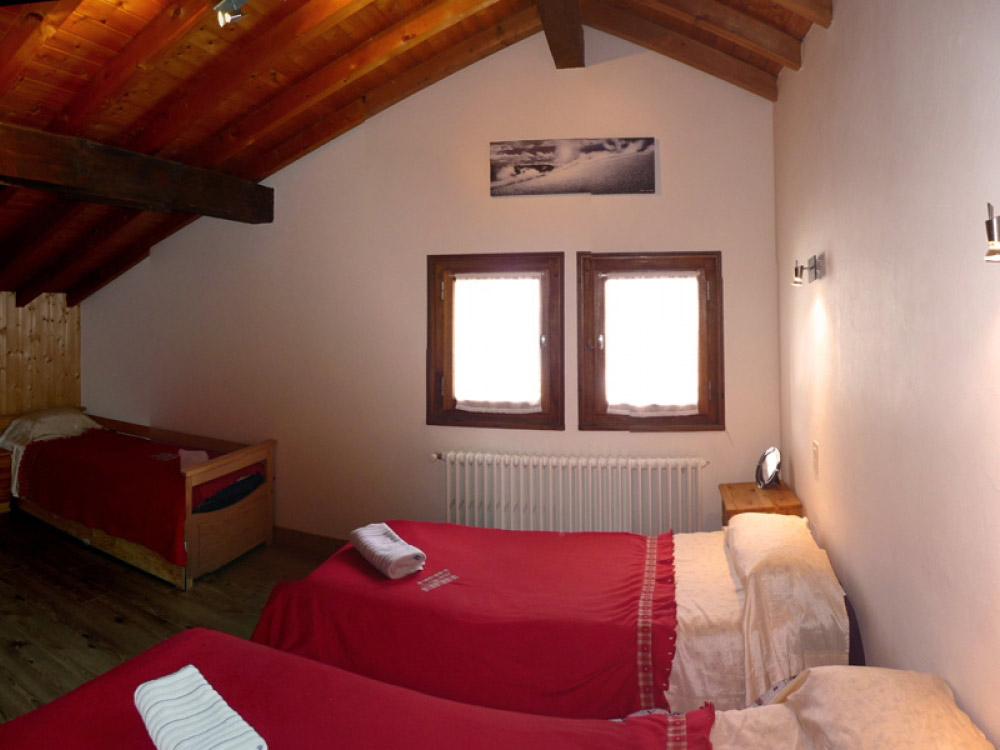 One of Chalet Chez Claude's welcoming bedrooms, we accommodate up to 12