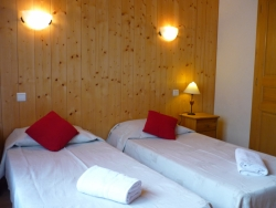 One of Chalet Chez Claude's comfortable bedrooms, we accommodate up to 12