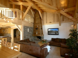 The living room of Chalet Starski with a roaring log fire