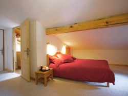 One of Chalet Ancolies Lodge's charming bedrooms, we accommodate up to 21