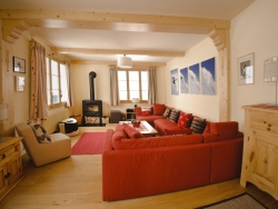 The spacious and comfortable lounge with two seating areas and cosy log fire