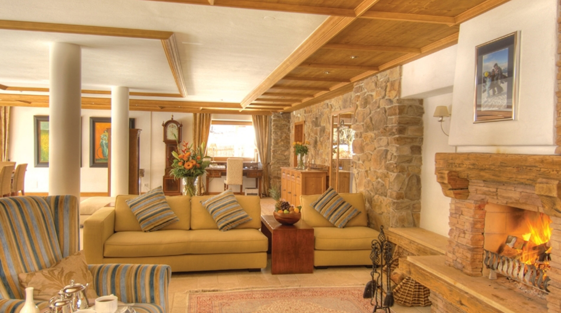 The extensive living room of Luxury Chalet Panorama in Maria Alm with a roaring log fire