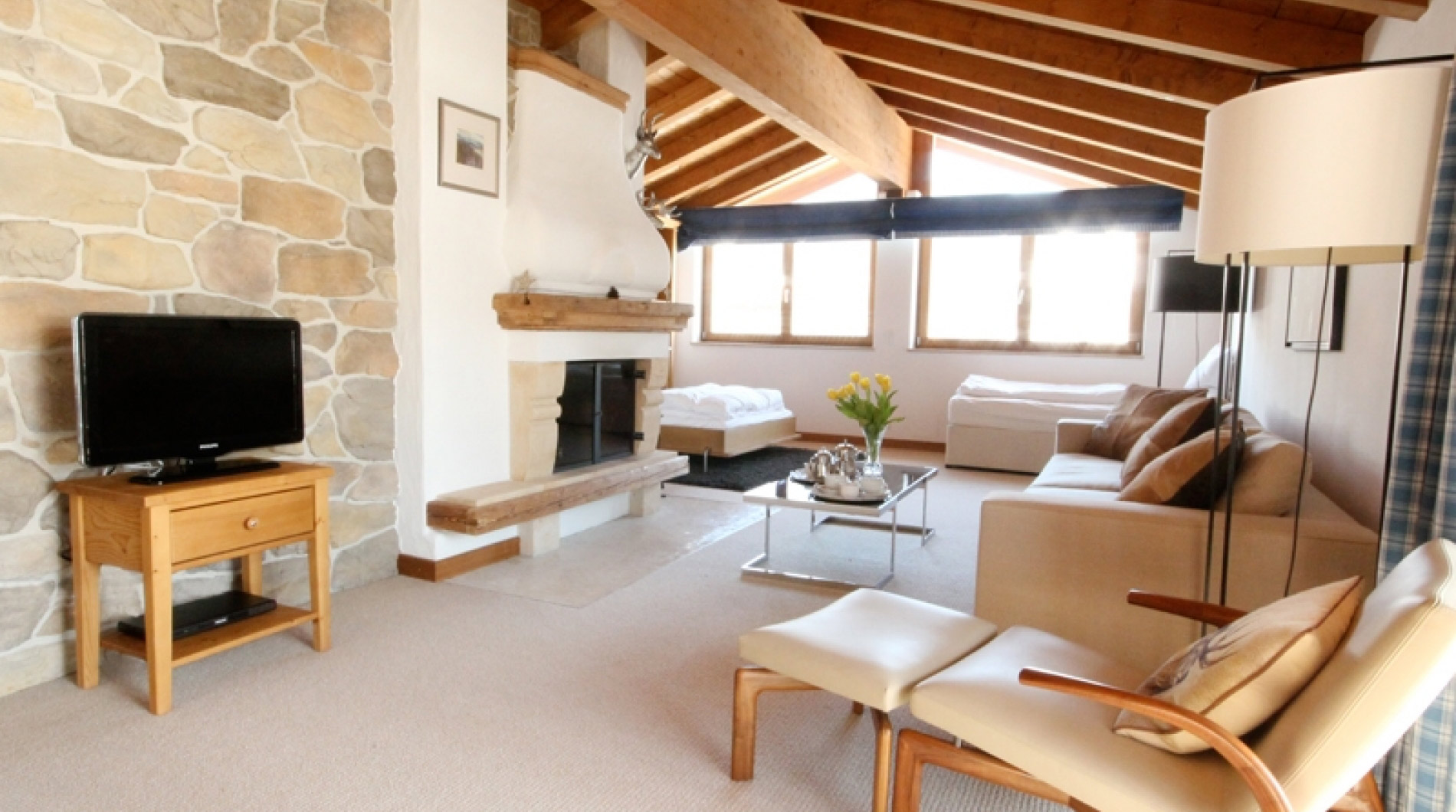 The comfortable sitting room of the Luxury Penthouse apartment in Chalet Panorama with charming log fire