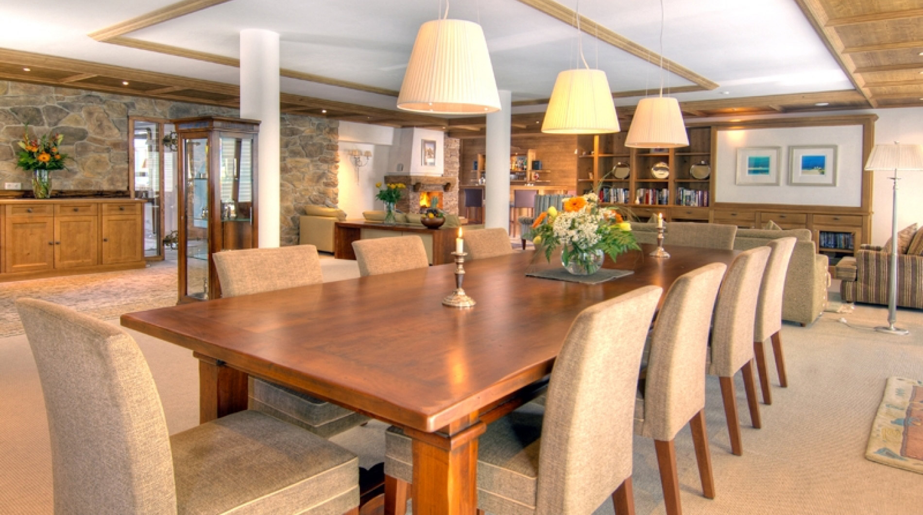 The dining area  of Luxury Chalet Panorama in Maria Alm with a roaring log fire