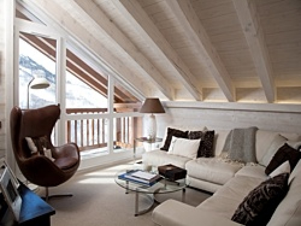 The lounge of Chalet Floralie - Penthouse offering free wifi, TV & DVD