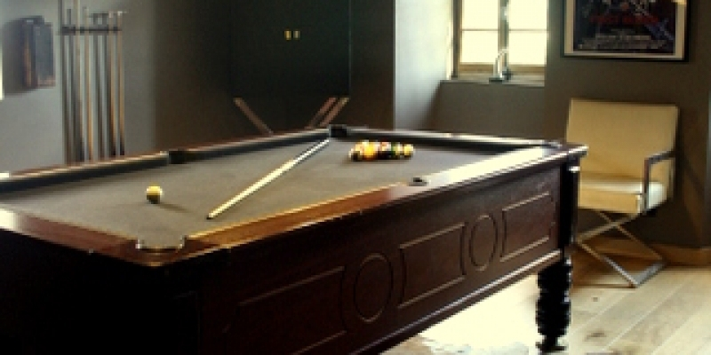 Guests enjoy the chalet facilities in the evenings from a game of pool to soaking in the hot tub