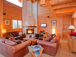 Relax in the squashy leather sofas in front of the roaring log fire at Chalet La Luge